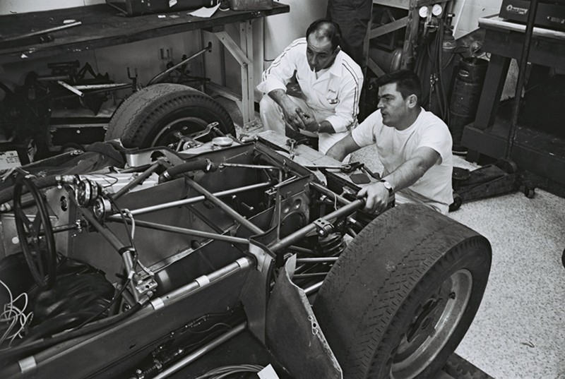 Mickey Thompson and the crew continue making adjustments to his 1964 racers at indy 500