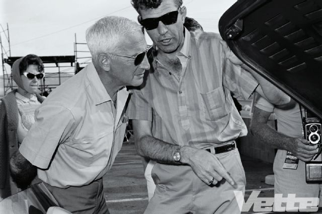 Carroll Shelby gives Zora Arkus-Duntov a peek under the hood of his brutal Ford Cobra