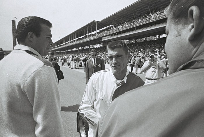 Dave MacDonald and John Mecom talk on the starting grid for the 1964 Indy 500