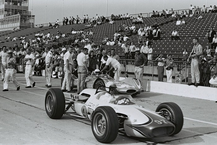 Masten Gregory tells Mickey Thompson that the car continues to lift. Parnelli Jones heads out for a run